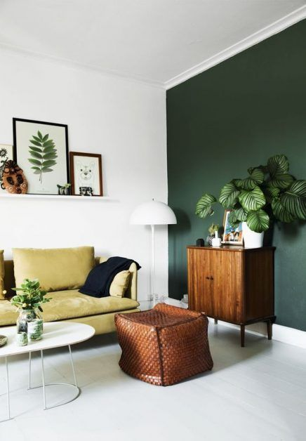 Complement a green wall with visual textures in other shades of the colour.
