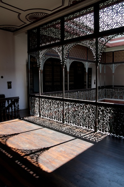 The Oriental geometric patterns are evident in the mansion's iron pillars.