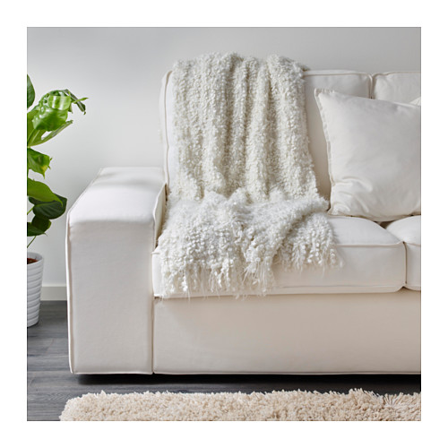 Furry throw from IKEA that can be used on the sofa or bed to add hygge.